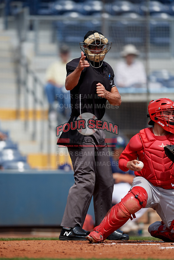 Umpire Dillon Wilson calls a strike during a Florida State League game between the Palm Beach Cardinals and Charlotte Stone Crabs on April 14, 2019 at Charlotte Sports Park in Port Charlotte, Florida.  Palm Beach defeated Charlotte 5-3.  (Mike Janes/Four Seam Images)