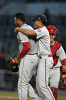 Pitcher Denyi Reyes (41) of the Greenville Drive is congratulated after using just 92 pitches to post a nine-inning complete-game shutout against the Columbia Fireflies on Sunday, May 27, 2018, at Spirit Communications Park in Columbia, South Carolina. Greenville won, 3-0. It was the first complete-game shutout in the South Atlantic League this season.(Tom Priddy/Four Seam Images)