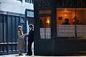 London, UK. 27.10.2014. Jonathan Miller's production, for English National Opera, of LA BOHEME, by Giacomo Puccini, opens at the London Coliseum. Rising star soprano, Angel Blue, makes her role debut as Mimi. Picture shows: a street scene. Photograph © Jane Hobson.