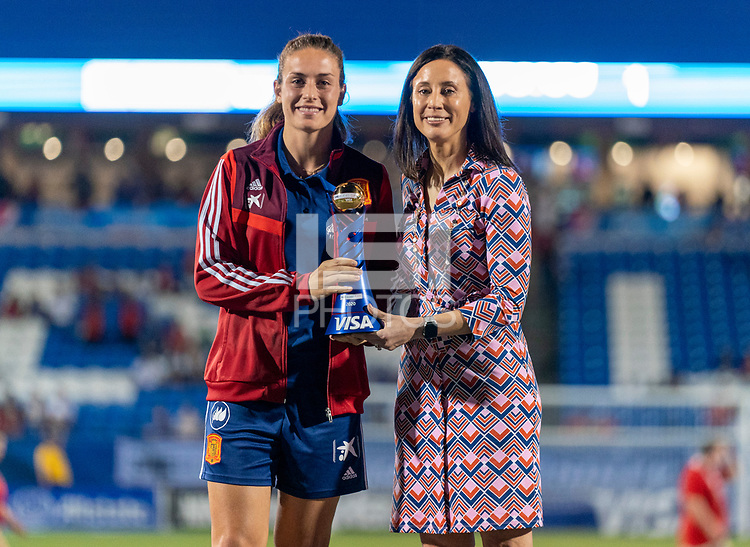 FRISCO, TX - MARCH 11: Alexia Putellas #11 of Spain receives the MVP trophy from Kate Markgraf of the United States during a game between Japan and USWNT at Toyota Stadium on March 11, 2020 in Frisco, Texas.