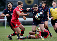 Pete Austin of London Scottish is tackled by Kieran Hardy of Jersey Reds during the Greene King IPA Championship match between London Scottish Football Club and Jersey at Richmond Athletic Ground, Richmond, United Kingdom on 16 December 2017. Photo by Mark Kerton / PRiME Media Images.
