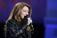 """Isabelle Boulay performs at the """"Paris-Quebec"""" show of the 44th Festival d'ete de Quebec on the Plains of Abraham in Quebec city Thursday July 7, 2011."""