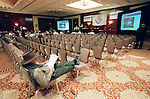CONTACT FILED:  ENRON CORP...Chet David from Las Angeles, California stretches out as he views a list of auction items as the second Enron auction procedes. Fewer that 100 buyers were present in the ballroom of the Hotel Intercontinental on West Loop 610, although there were also buyers who bid through the internet. Photo by Steve Campbell, 12/3/02.  HOUCHRON CAPTION  (12/04/2002):  Chet David of Los Angeles stretches out to study a list of sale items during the second Enron liquidation auction Tuesday in Houston. Only about 200 people were at the Hotel Inter-Continental for the auction, which continues today and Thursday. September's auction drew about 1,000 people...