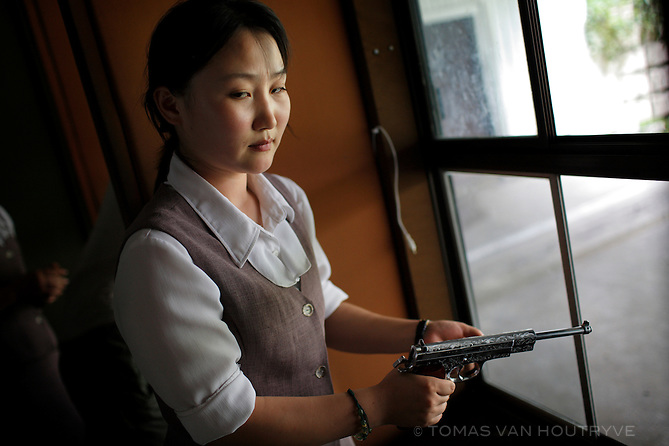 A North Korean woman loads a pistol for firing practice in Pyongyang, North Korea (DPRK) on 18 August, 2007.