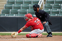 Lakewood BlueClaws catcher Colby Fitch (25) reaches for a low pitch as home plate umpire Harley Acosta looks on during the game against the Kannapolis Intimidators at Kannapolis Intimidators Stadium on April 8, 2018 in Kannapolis, North Carolina.  The Intimidators defeated the BlueClaws 4-3 in game two of a double-header.  (Brian Westerholt/Four Seam Images)