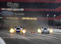 Jun. 15, 2012; Bristol, TN, USA: NHRA funny car driver Ron Capps (left) races alongside Bob Bode during qualifying for the Thunder Valley Nationals at Bristol Dragway. Mandatory Credit: Mark J. Rebilas-