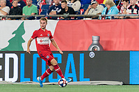 FOXBOROUGH, MA - AUGUST 25: Djordje Mihailovic #14 of Chicago Fire looks to pass during a game between Chicago Fire and New England Revolution at Gillette Stadium on August 24, 2019 in Foxborough, Massachusetts.
