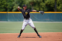 Pittsburgh Pirates shortstop Robbie Glendinning (10) warmup throw to first base during an Instructional League intrasquad black and gold game on September 28, 2017 at Pirate City in Bradenton, Florida.  (Mike Janes/Four Seam Images)