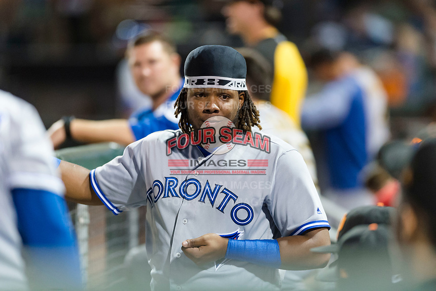 Surprise Saguaros third baseman Vladimir Guerrero Jr. (27), of the Toronto Blue Jays organization, in the dugout during an Arizona Fall League game against the Scottsdale Scorpions at Scottsdale Stadium on October 15, 2018 in Scottsdale, Arizona. Surprise defeated Scottsdale 2-0. (Zachary Lucy/Four Seam Images)
