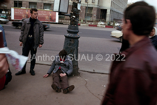 """Moscow, Russia<br /> October 22, 1992<br /> <br /> Leaving the poor and pensioners with little, street drinks appear in number as well as alcohol advertisements, which are some of the first commercials to arrive in Russia.<br /> <br /> In December 1991, food shortages in central Russia had prompted food rationing in the Moscow area for the first time since World War II. Amid steady collapse, Soviet President Gorbachev and his government continued to oppose rapid market reforms like Yavlinsky's """"500 Days"""" program. To break Gorbachev's opposition, Yeltsin decided to disband the USSR in accordance with the Treaty of the Union of 1922 and thereby remove Gorbachev and the Soviet government from power. The step was also enthusiastically supported by the governments of Ukraine and Belarus, which were parties of the Treaty of 1922 along with Russia.<br /> <br /> On December 21, 1991, representatives of all member republics except Georgia signed the Alma-Ata Protocol, in which they confirmed the dissolution of the Union. That same day, all former-Soviet republics agreed to join the CIS, with the exception of the three Baltic States."""
