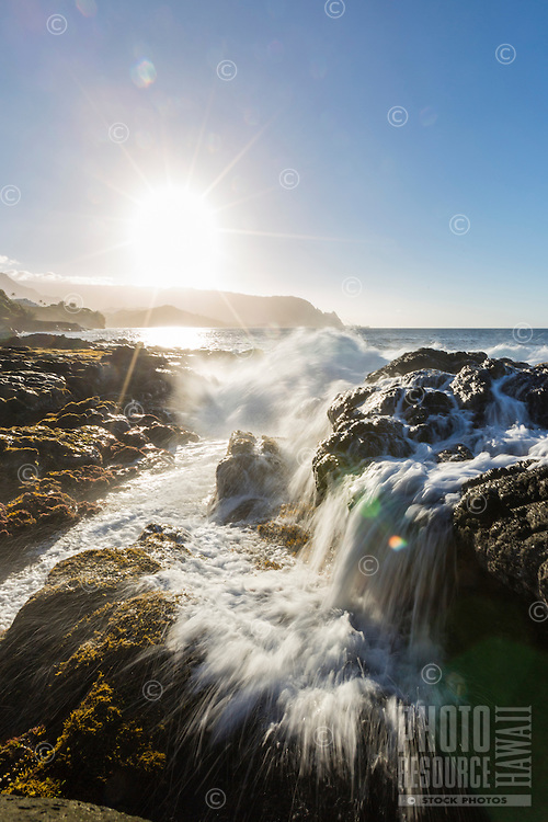 A slow shutter image of waves breaking on lava rock at Queen's Bath, Kaua'i. A sacred place where visitors must be very careful of the incoming surf!