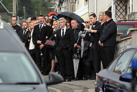 """COPY BY TOM BEDFORD<br /> Pictured: Mourners gather outside the family home in Merthyr Tydfil, Wales, UK. Friday 18 August 2017<br /> Re: The funeral of a toddler who died after a parked Range Rover's brakes failed and it hit a garden wall which fell on top of her will be held today at Jerusalem Baptist Chapel in Merthyr Tydfil.<br /> One year old Pearl Melody Black and her eight-month-old brother were taken to hospital after the incident in south Wales.<br /> Pearl's family, father Paul who is The Voice contestant and mum Gemma have said she was """"as bright as the stars""""."""