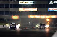 May 18, 2012; Topeka, KS, USA: NHRA funny car driver Bob Bode (right) races alongside Matt Hagan during qualifying for the Summer Nationals at Heartland Park Topeka. Mandatory Credit: Mark J. Rebilas-