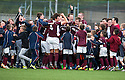 Stenhousemuir players celebrate with the fans at the end of the game.