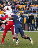 Pitt linebacker Nicholas Grigsby (3) sacks Louisville Cardinal quarterback Kyle Bolin forcing a fumble. The Pitt Panthers football team defeated the Louisville Cardinals 45-34 on Saturday, November 21, 2015 at Heinz Field, Pittsburgh, Pennsylvania.