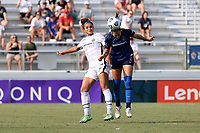 CARY, NC - SEPTEMBER 12: Kaleigh Kurtz #3 of the North Carolina Courage heads the ball away from Sophia Smith #9 of the Portland Thorns FC during a game between Portland Thorns FC and North Carolina Courage at Sahlen's Stadium at WakeMed Soccer Park on September 12, 2021 in Cary, North Carolina.
