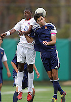 HYATTSVILLE, MD - OCTOBER 26, 2012:  Arion Sobers-Assue (13) of DeMatha Catholic High School goes up for a header against Arjan Ganji (10) of St. Albans during a match at Heurich Field in Hyattsville, MD. on October 26. DeMatha won 2-0.