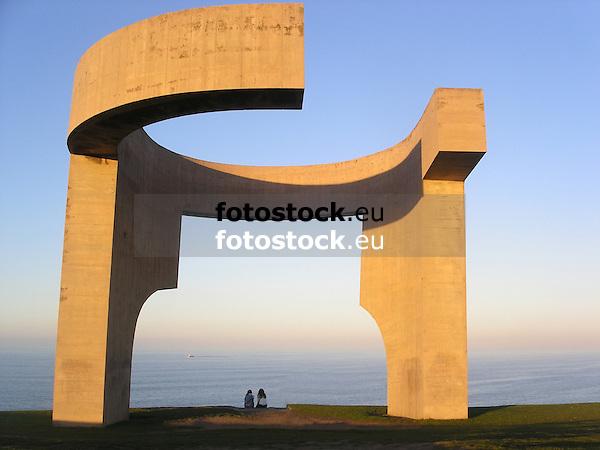 """Sculpture """"Elogio del Horizonte"""" (1990, concrete, 10 m) by the famous basque artist Eduardo Chillida (1924-2002 San Sebastian) in Atalaya Park<br /> <br /> Escultura """"Elogio del Horizonte"""" (1990, hormigón armado, 10 m) por el famoso artista vasco Eduardo Chillida (1924-2002 San Sebastián - vas. Donostia) en el Parque de La Atalaya, Cerro Santa Catalina, Cimadevilla<br /> <br /> Skulptur """"Elogio del Horizonte"""" (Lob des Horizonts) (1990, Beton, 10 m) von dem berühmten baskischen Künstler Eduardo Chillida (1924-2002 San Sebastián), Atalaya Park<br /> <br /> 2272 x 1704 px<br /> 150 dpi: 38,47 x 28,85 cm<br /> 300 dpi: 19,24 x 14,43 cm"""