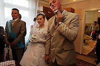 "The first event of the three-day ceremony is the wedding ceremony itself at the small town hall. The groom wipes sweat off his face just before saying ""I do."" <br /> Bride  is Miroslava Osipova.  Groom is Ivan Osipova. Best man is Leonid Petukhov.<br /> ALL ARE RELEASED....."