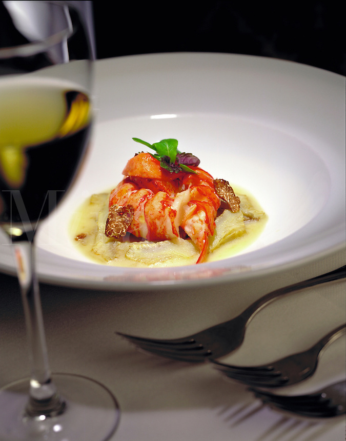 Gourmet lobster dish with glass of white wine. Atlanta, Georgia.