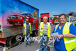 George Bird with r-l: Gerry Curry and Michael Mangan delighted to be back setting up the Bird's Amusements in Killarney on Tuesday