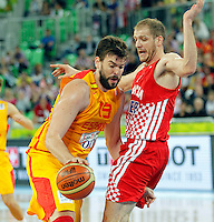 "Marc Gasol of Spain (L) and Luka Zoric of Croatia (R) in action during European basketball championship ""Eurobasket 2013""  basketball game for 3rd place between Spain and Croatia in Stozice Arena in Ljubljana, Slovenia, on September 22. 2013. (credit: Pedja Milosavljevic  / thepedja@gmail.com / +381641260959)"