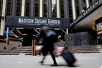 NEW YORK - NEW YORK - APRIL 02: A woman walks in front of Madison Square Garden on April 02, 2021 in New York. New York takes another step forward to reopening arts and entertainment, venues are allowed to welcome back people with the guidelines say indoor spaces can have up to 100 audience members and outdoor venues can have 200. (Photo by John Smith/VIEWpress)