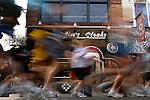 Runners pass by Jim's Steaks on South Street during the Philadelphia Marathon in Philadelphia, Pennsylvania on November 19, 2006.