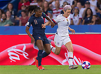 PARIS,  - JUNE 28: Kadidiatou Diani #11 fights for the ball with Megan Rapinoe #15 during a game between France and USWNT at Parc des Princes on June 28, 2019 in Paris, France.