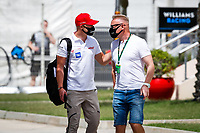 26th March 2021; Sakhir, Bahrain; F1 Grand Prix of Bahrain, Free Practice sessions;  MAZEPIN Nikita (rus), Haas F1 Team VF-21 Ferrari with his father Dmitry arrives trackside during Formula 1 Gulf Air Bahrain Grand Prix 2021