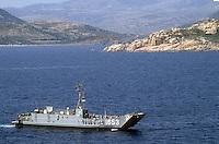 - US landing craft approach the beach of Cape Teulada military polygon (Sardinia) ....- mezzo da sbarco USA si avvicina alla spiaggia del poligono militare di Capo Teulada (Sardegna)