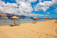 Beach & sunbeds on Agrostoli Bay near Lixouri, Kefalonia, Ionian Islands, Greece.