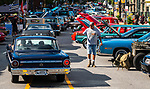 TORRINGTON, CT 073021JS16 Gary Hurlbut of Winchester, gives a thumbs-up to the owner of a Ford Falcon as he walks through the Main Street Cruise Friday in downtown Torrington. The car show and carnival benefits Torrington PAL and the police department's Explorers program.  This was the first downtown car show since 2019. <br />  Jim Shannon Republican American