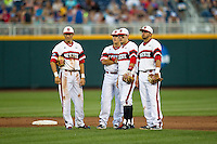 North Carolina State (L to R) shortstop Trea Turner (8),  second baseman Logan Ratledge (6), third baseman Grant Clyde (22) and first baseman Tarran Senay (32) during a pitching change against the UCLA Bruins during Game 8 of the 2013 Men's College World Series on June 18, 2013 at TD Ameritrade Park in Omaha, Nebraska. The Bruins defeated the Wolfpack 2-1, eliminating North Carolina State from the tournament. (Andrew Woolley/Four Seam Images)