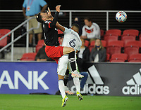 WASHINGTON, DC - MAY 13: Brendan Hines Ike #4 of D.C. United battles for the ball with Miguel Angel Navarro #6 of Chicago Fire during a game between Chicago Fire FC and D.C. United at Audi FIeld on May 13, 2021 in Washington, DC.