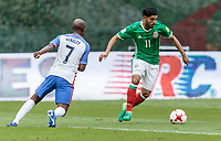 Mexico City, Mexico - Sunday June 11, 2017: DaMarcus Beasley, Carlos Vela during a 2018 FIFA World Cup Qualifying Final Round match with both men's national teams of the United States (USA) and Mexico (MEX) playing to a 1-1 draw at Azteca Stadium.