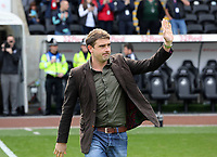 Pictured: Former Swansea player James Thomas greets the crowd on the tenth anniversary of Swansea's win against Hull in which he scored a hat trick helping Swansea to stay in the League. Saturday 04 May 2013<br /> Re: Barclay's Premier League, Swansea City FC v Manchester City at the Liberty Stadium, south Wales.