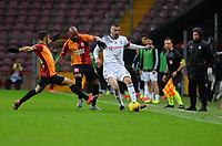 15th March 2020, Istanbul, Turkey;   Burak Yilmaz of Besiktas takes on Marcelo Saracchi and Marcao of Galatasaray during the Turkish Super league football match between Galatasaray and Besiktas at Turk Telkom Stadium in Istanbul , Turkey on March 15 , 2020.