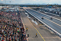Feb 23, 2020; Chandler, Arizona, USA; NHRA fans in the crowd look on as top fuel driver Steve Torrence (left) alongside father Billy Torrence during the Arizona Nationals at Wild Horse Pass Motorsports Park. Mandatory Credit: Mark J. Rebilas-USA TODAY Sports