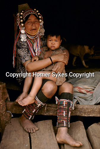 Akha Hill Tribe Northern Thailand village of Pala South East Asia Grand mother and grandson 1990s