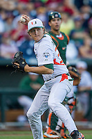 Miami Hurricanes pitcher Cooper Hammond (39) makes a throw to first base during the NCAA College baseball World Series against the Arkansas Razorbacks  on June 15, 2015 at TD Ameritrade Park in Omaha, Nebraska. Miami beat Arkansas 4-3. (Andrew Woolley/Four Seam Images)