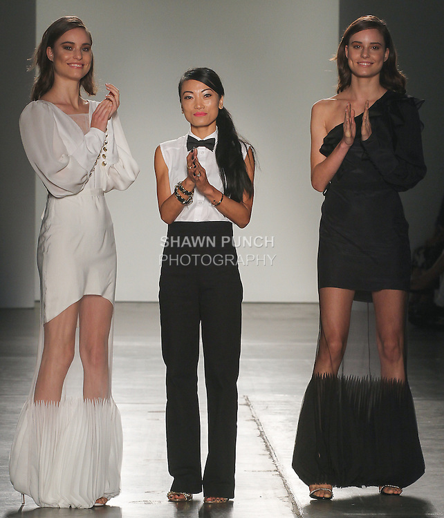 Fashion designer Luom Ousby walks runway with models at the close of her show Luom.O collection fashion show, for Fashion Palette Australian Evening & Bridal Show Spring Summer 2016, duing New York Fashion Week Spring 2016.