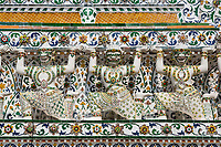 Bangkok, Thailand.  Wat Arun Architectural Detail.  Yakshas Holding up the Overhead Structure.