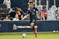 KANSAS CITY, KS - AUGUST 10: Kayden Pierre #24 Sporting KC with the ball during a game between Club Leon and Sporting Kansas City at Children's Mercy Park on August 10, 2021 in Kansas City, Kansas.