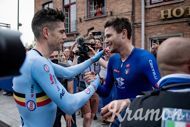 Filippo Ganna (ITA/Ineos Grenadiers) succesfully defends his TT title and is congratulated post-finish by runner-up Wout van Aert (BEL/Jumbo-Visma)<br /> <br /> Men Elite Individual Time Trial <br /> from Knokke-Heist to Bruges (43.3 km)<br /> <br /> UCI Road World Championships - Flanders Belgium 2021<br /> <br /> ©kramon