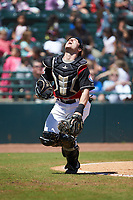 Hickory Crawdads catcher Matt Whatley (19) tracks a pop fly during the game against the Charleston RiverDogs at L.P. Frans Stadium on May 13, 2019 in Hickory, North Carolina. The Crawdads defeated the RiverDogs 7-5. (Brian Westerholt/Four Seam Images)