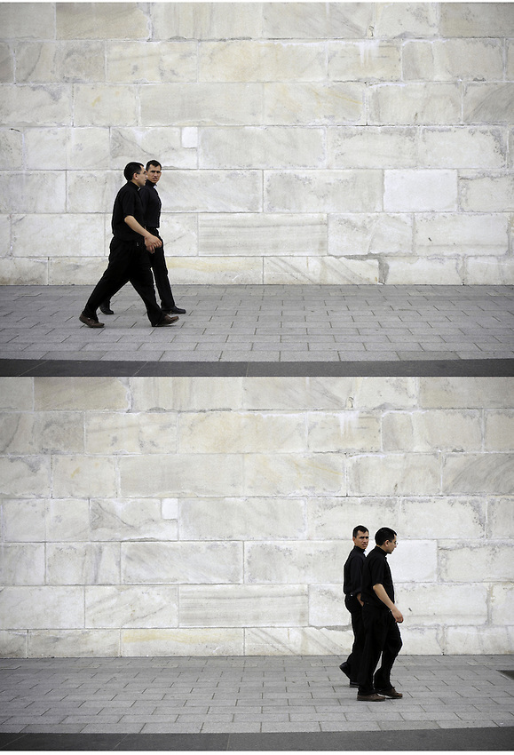 Two priests walking past the Washington monument, Was, DC.