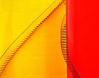 Red & Yellow oil storage tanks.