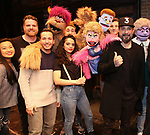 """Howie Dorough and  AJ McLean from the Backstreet Boys backstage with  the cast and crew of  """"Avenue Q""""  at the New World Stages on January 27, 2019 in New York City."""