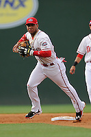 Second baseman Yoan Moncada (24) of the Greenville Drive prepares to throw out a runner in a game against the Lexington Legends on Monday, May 18, 2015, at Fluor Field at the West End in Greenville, South Carolina. Moncada, a 19-year-old prospect from Cuba, made his professional debut tonight in the Red Sox organization. (Tom Priddy/Four Seam Images)